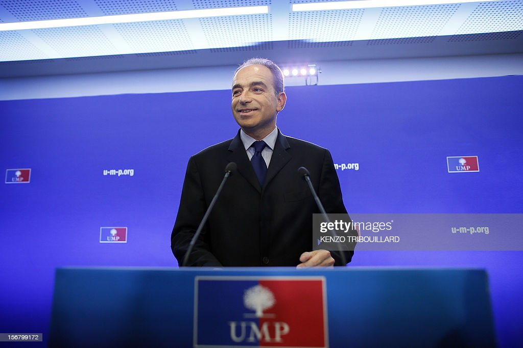 Newly-elected president of the right-wing UMP opposition party, Jean-Francois Cope, arrives for a press conference on November 21, 2012 at the UMP's headquarters in Paris. Former French prime minister Francois Fillon, who lost by just 98 votes to Nicolas Sarkozy's close ally Jean-Francois Cope in Sunday's vote, said the count did not include ballots cast in some of France's overseas territories which would have handed him victory. Cope, a fiery and famously ambitious right-winger known for flirting with the far-right, rejected any talk of overturning the results and called for the party to unite under his banner. AFP PHOTO KENZO TRIBOUILLARD