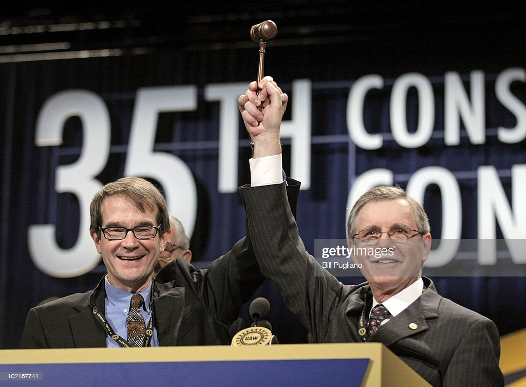 Newly-elected United Auto Workers president Bob King (L) hoists the gavel that was passed to him by former president Ron Gettelfinger at the 2010 UAW Constitutional Convention June 17, 2010 in Detroit, Michigan. King is replacing Gettelfinger, who served as UAW President for the past eight years.