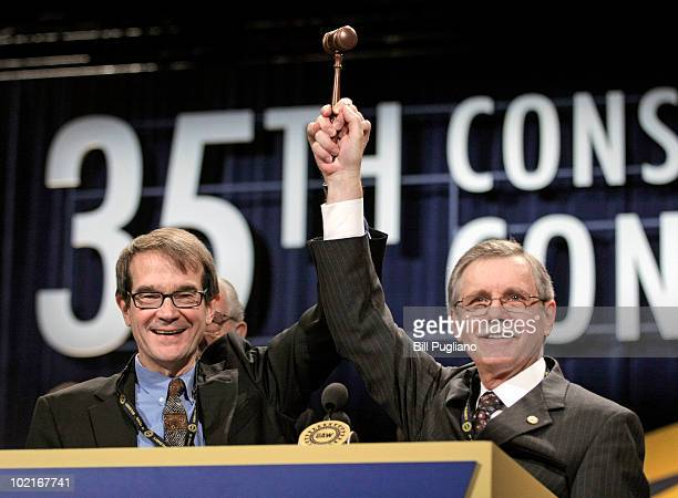 Newlyelected United Auto Workers president Bob King hoists the gavel that was passed to him by former president Ron Gettelfinger at the 2010 UAW...