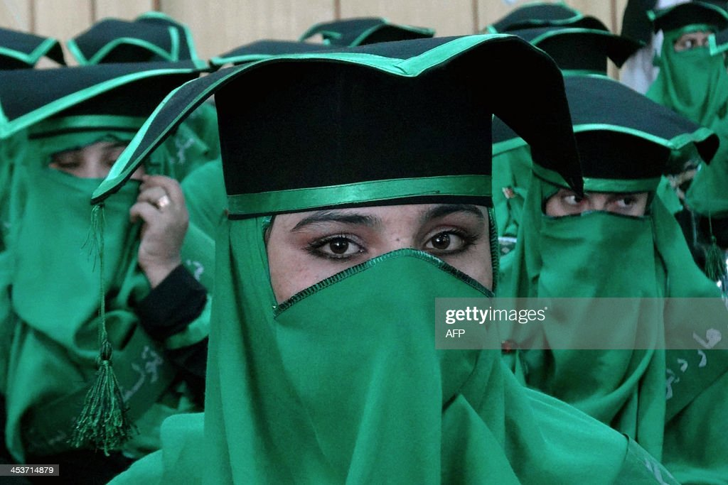 Newly-graduated Afghan midwives attend a commencement ceremony at the Governor's House in Jalalabad, Nangarhar province on December 5, 2013. Some 40 midwives graduated in the ceremony after undergoing a two and half year midwifery programme. AFP PHOTO/Noorullah Shirzada