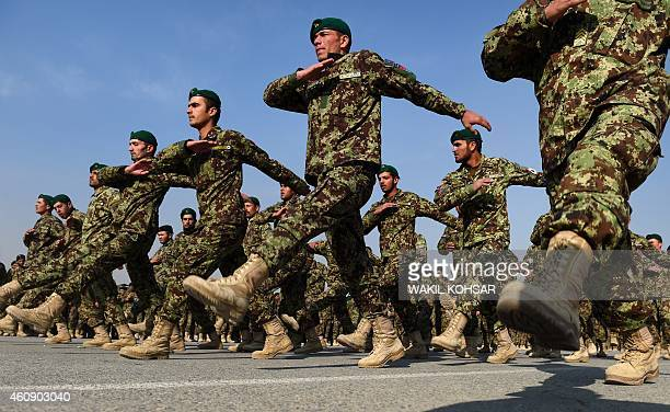 Newlygraduated Afghan National Army cadets march as they attend their graduation ceremony at the Afghan Kabul Military training centre in Kabul on...
