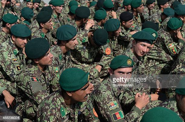 Newlygraduated Afghan National Army officers attend a graduation ceremony at the Afghan National Army training centre in Kabul on September 11 2014...