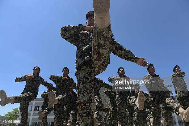 Newlygraduated Afghan National Army soldiers march during their graduation ceremony at the Afghan National Army training centre in Kabul on June 1...