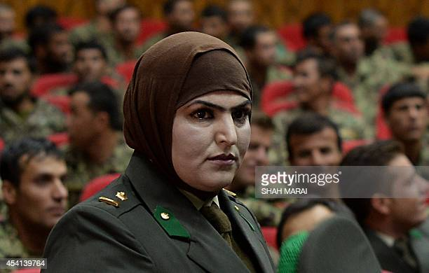 A Newlygraduated female Afghan National Army officer attends a graduation ceremony at the Afghan National Army training centre in Kabul on August 24...