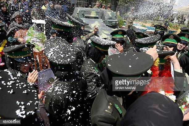 Newlygraduated female Afghan National Army officers are showered with confetti foam after a graduation ceremony at the Afghan National Army training...