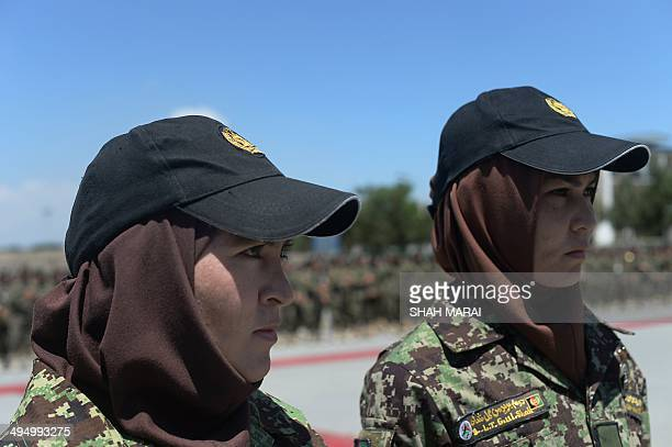 Newlygraduated female Afghan National Army officers Gulshan and Mariam Yosofi attend their graduation ceremony at the Afghan National Army training...