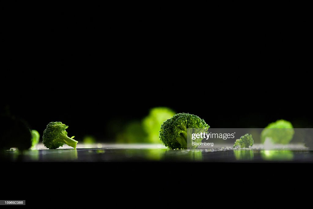 Newly-harvested broccoli spears pass through a screening machine at the Monliz-Produtos Alimentares do Mondego e Liz SA frozen food factory in Alpiarca, Portugal, on Friday, Jan. 18, 2013. Portuguese Prime Minister Pedro Passos Coelho says he does not want Portugal to get a second rescue program. Photographer: Mario Proenca/Bloomberg via Getty Images