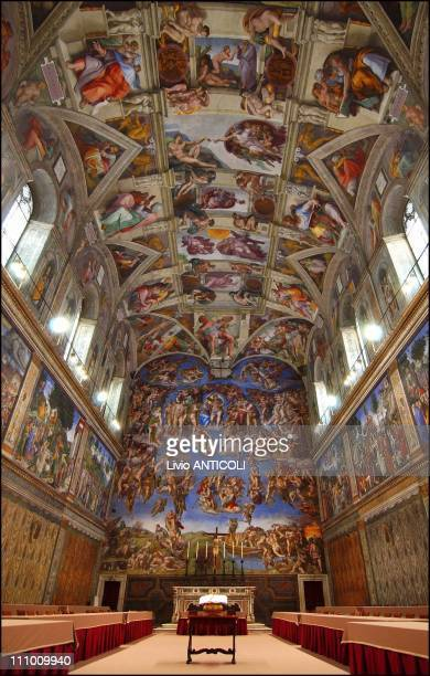 Newlyinstalled tables stand under Michaelangelo's frescoes in the Vatican's Sistine Chapel where Conclave of Cardinals will be hosted to pick the...