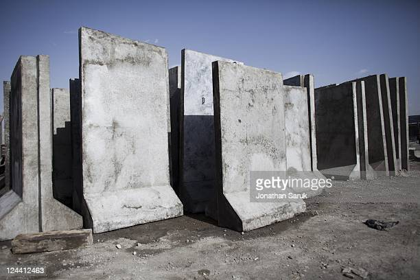 Newlymade concrete blast walls at a construction site June 14 2011 on the outskirts of Kabul Afghanistan Blast walls are ubiquitous on the streets of...