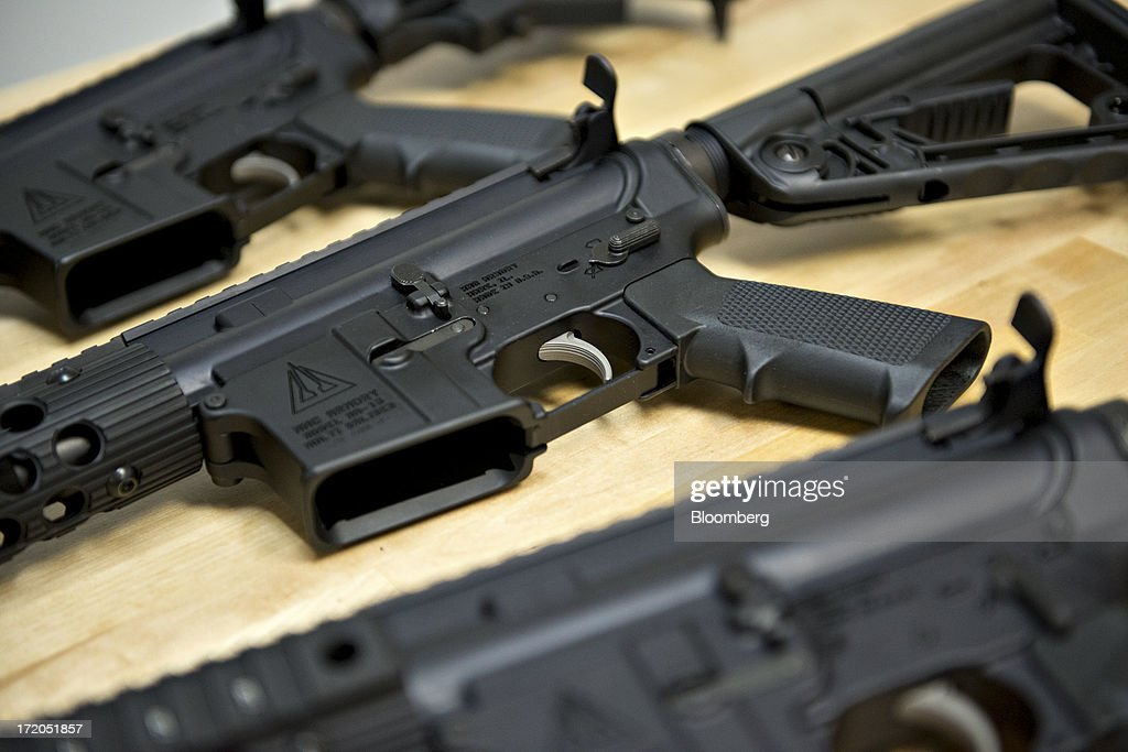 Newlymanufactured MMC Armory MA15 rifles are displayed for a photograph at MMC Armory a division of Mennie Machine Co in Mark Illinois US on...