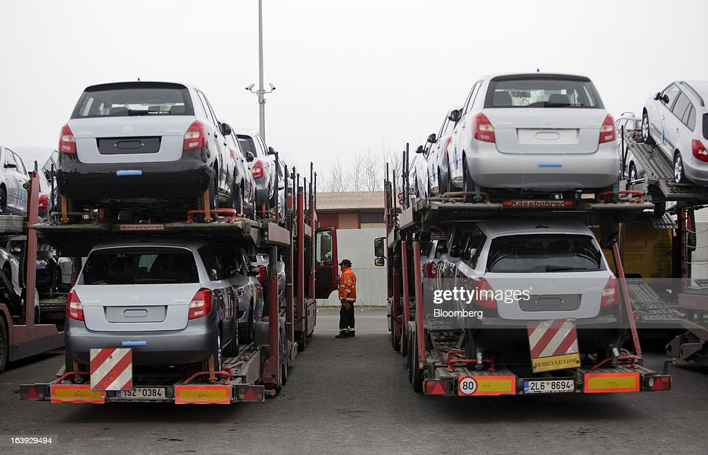 Newly-manufactured Skoda automobiles stand on transport trucks for distribution at the Skoda Autos AS plant in Mlada Boleslav, Czech Republic, on Friday, March 15, 2013. VW, which also owns the Porsche luxury-auto brand as well as the Skoda and Seat volume marques, will build at least 10 plants globally, including seven in China, Martin Winterkornm chief executive officer of Volkswagen AG, said. Photographer: Martin Divisek/Bloomberg via Getty Images