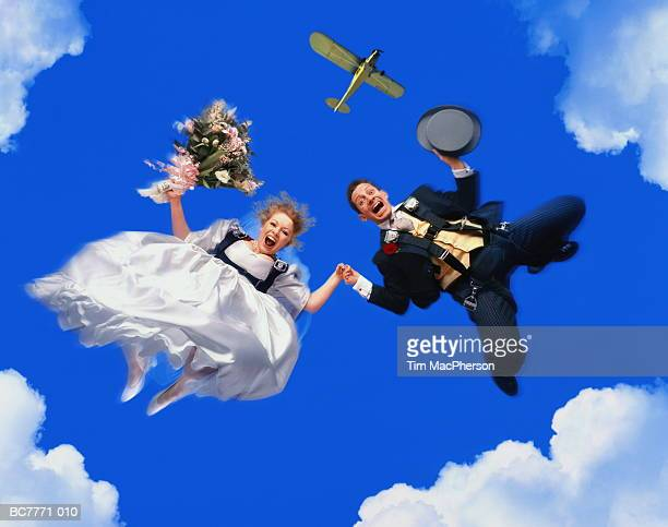 Newly-married couple leaping from plane (Digital Composite)