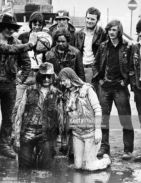 Newlymarried Golly and Sugar are baptised by Scouse watched by their biker friends