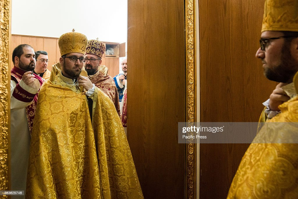 Newlyordained Father Avedis takes a final look at his vestments before entering the sanctuary for the consecration service Archbishop Khajag...