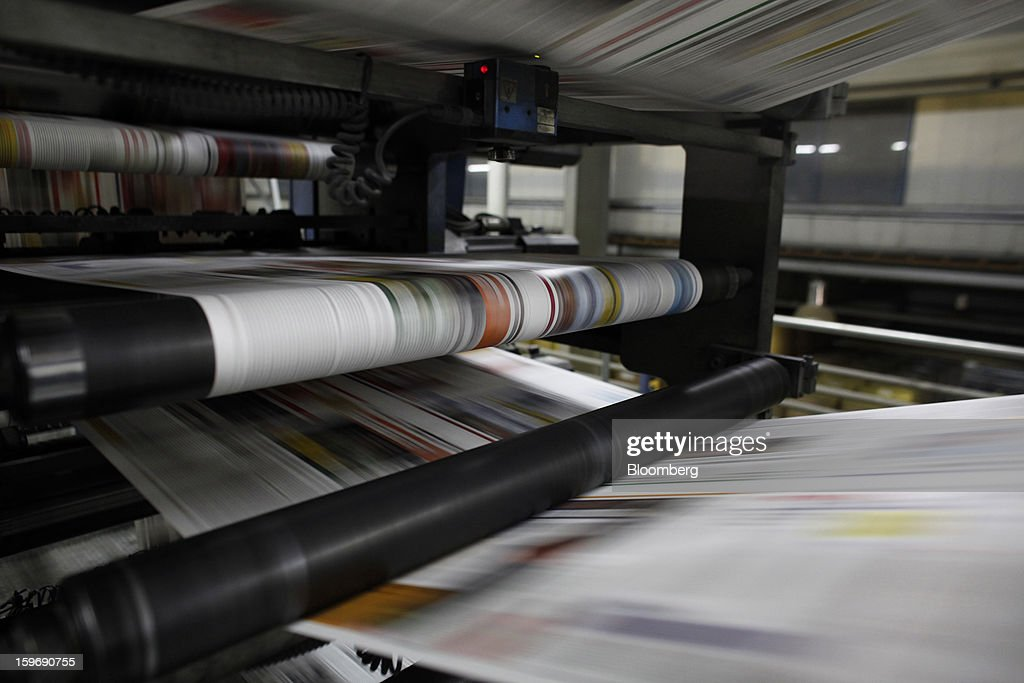 Newly-printed colour newspaper pages pass through the automated presses at the Kathimerini printing plant in Paiania, Greece, on Thursday, Jan. 17, 2013. An anarchist group claimed responsibility for a series of attacks early on Jan. 11 when unidentified perpetrators threw makeshift bombs made from propane gas canisters into the homes of five Greek journalists working for national media saying it was to protest coverage of the country's financial crisis seen as sympathetic to the government. Photographer: Kostas Tsironis/Bloomberg via Getty Images