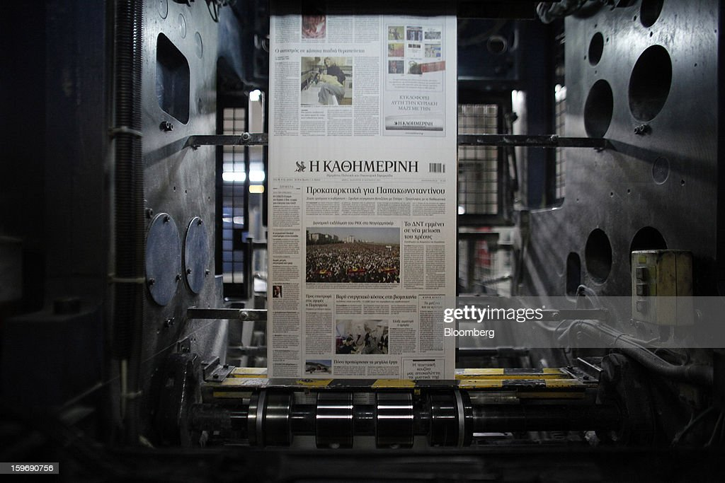 Newly-printed pages of the Kathimerini newspaper pass along the automated presses at the Kathimerini printing plant in Paiania, Greece, on Thursday, Jan. 17, 2013. An anarchist group claimed responsibility for a series of attacks early on Jan. 11 when unidentified perpetrators threw makeshift bombs made from propane gas canisters into the homes of five Greek journalists working for national media saying it was to protest coverage of the country's financial crisis seen as sympathetic to the government. Photographer: Kostas Tsironis/Bloomberg via Getty Images