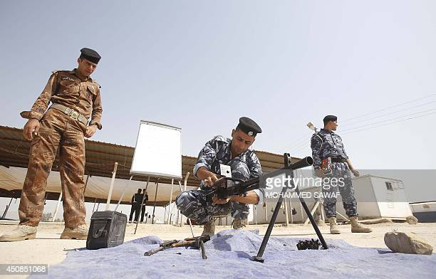 Newlyrecruited Iraqi volunteers in police uniforms attend a training session at the Ibrahimiya police camp outside the central Iraqi Shiite city of...