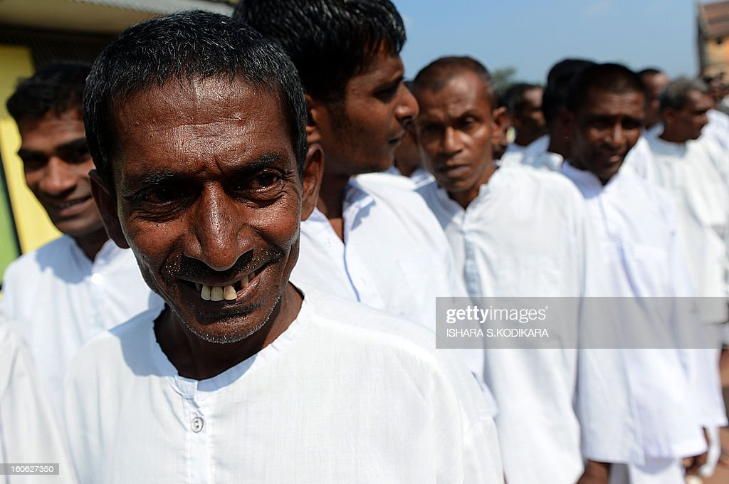 Newly-released Sri Lankan prisoners exit a prison complex during the country's 65th Independence Day in Colombo on February 4, 2013. Sri Lanka freed 1,270 convicts to mark the country's 65th anniversary of independence from Britain, prisons official said. Sri Lanka marked its freedom anniversary with a thinly veiled denunciation of Western moves to pass a new resolution against the island at the UN Human Rights Council. AFP PHOTO/Ishara S