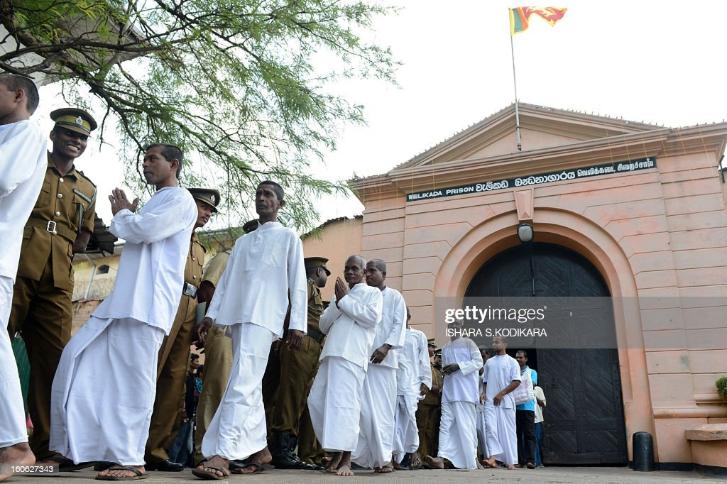 Newly-released Sri Lankan prisoners exit the Welikada prison during the country's 65th Independence Day in Colombo on February 4, 2013. Sri Lanka freed 1,270 convicts to mark the country's 65th anniversary of independence from Britain, prisons official said. Sri Lanka marked its freedom anniversary with a thinly veiled denunciation of Western moves to pass a new resolution against the island at the UN Human Rights Council. AFP PHOTO/Ishara S.KODIKARA