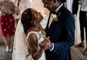 Newlywed African Descent Couple Dancing Wedding Celebration