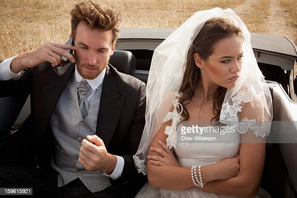 Newlywed couple arguing in car