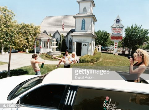 Newlywed Couple Coming Out of a Chapel and Friends With a Limousine, Nevada, USA
