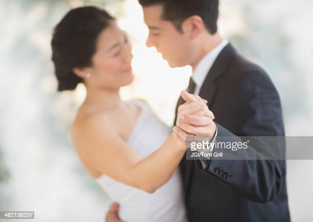 Newlywed couple dancing at wedding reception