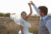 Newlywed couple dancing outdoors