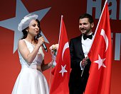 Newlywed couple Eda Bilir and Muhammet Furkan Engin participate the demonstration staged to protest and to show solidarity against Parallel...