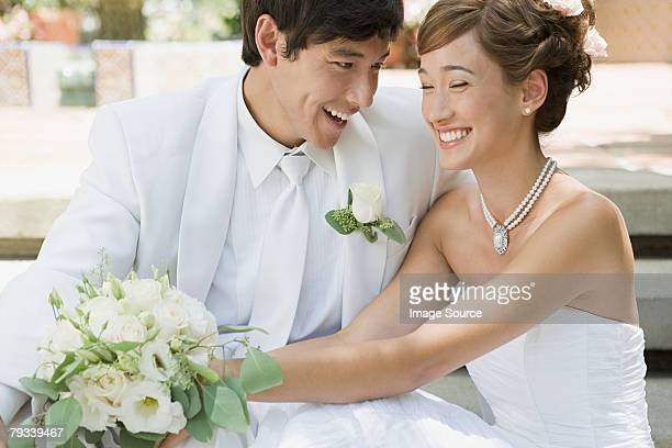 Newlywed couple holding a bouquet