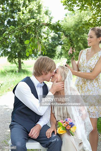 Newlywed couple kissing outdoors