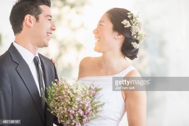 Newlywed couple laughing