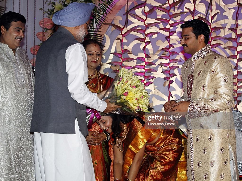 Newlywed couple of Sarang and Madhura Gadkari taking blessings from Prime Minister Manmohan Singh as Nitin Gadkari and Kanchan Gadkari looks on during their wedding reception on July 9, 2012 in New Delhi, India. Nitin Gadakari's younger son Sarang tied knot with his classmate Madhura on June 24, 2012 in Nagpur.