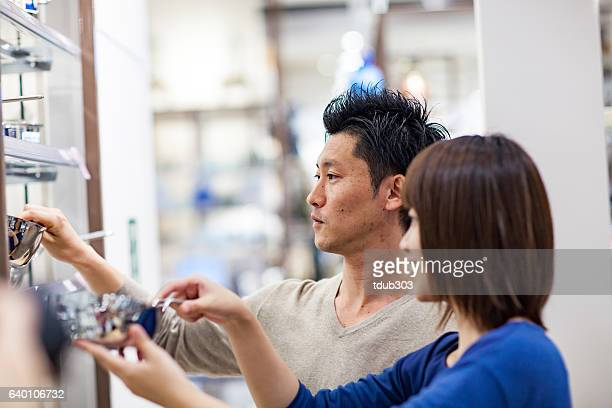 Newlywed couple selecting cookware at a department store