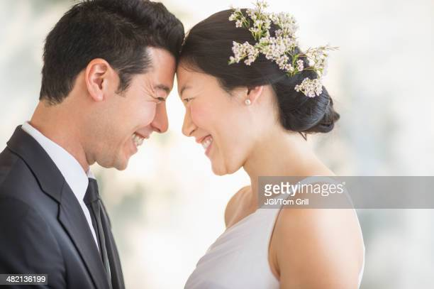 Newlywed couple smiling face to face