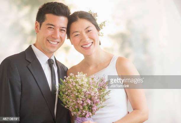 Newlywed couple smiling
