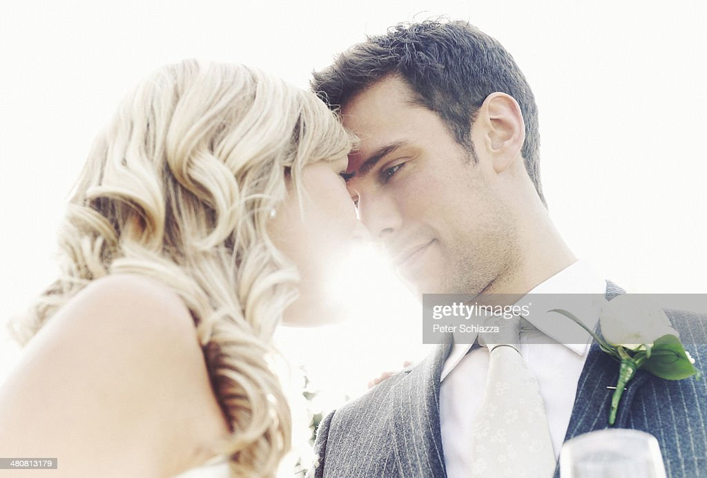Newlywed couple touching noses