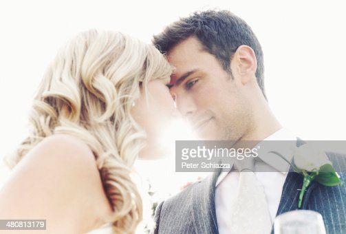 Newlywed couple touching noses