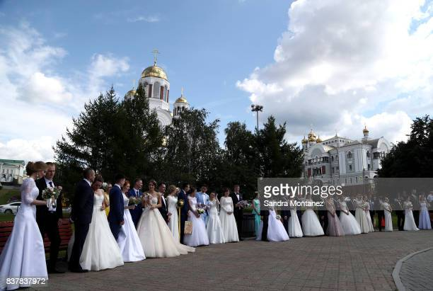 Newlywed couples are seen in front of The Savior on Blood Cathedral during a media tour of Russia 2018 FIFA World Cup venues on August 19 2017 in...