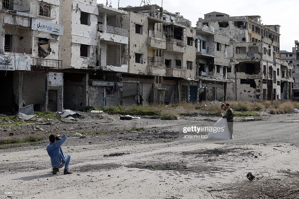 TOPSHOT Newlywed Syrian couple Nada Merhi and Hassan Youssef have their wedding pictures taken in the war ravaged city of Homs on February 5 2016 A...