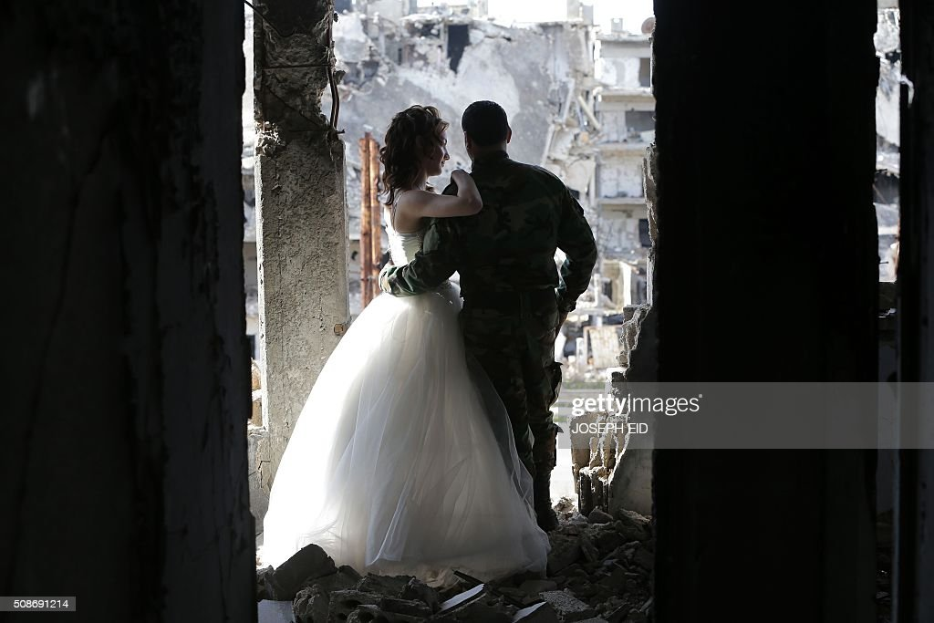 Newlywed Syrian couple Nada Merhi and Syrian army soldier Hassan Youssef have their wedding pictures taken in a heavily damaged building in the war...