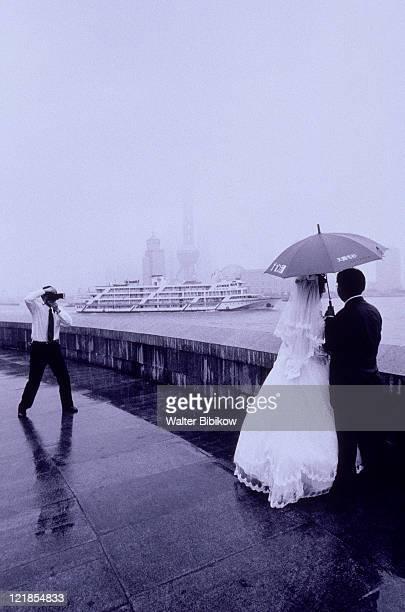 Newlywed under umbrella, Shanghai, China