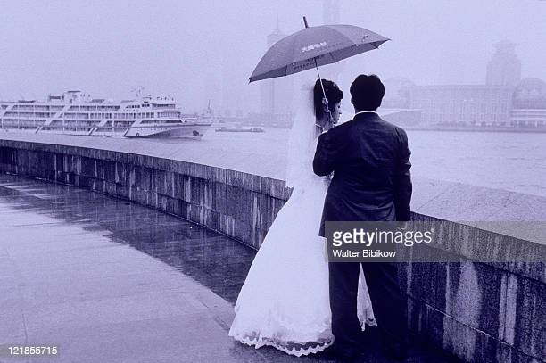 Newlywed under umbrella, Shanghai, China