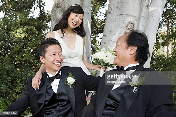 Newlyweds and father of bride