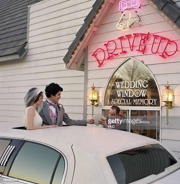 Newlyweds at drive-thru wedding chapel