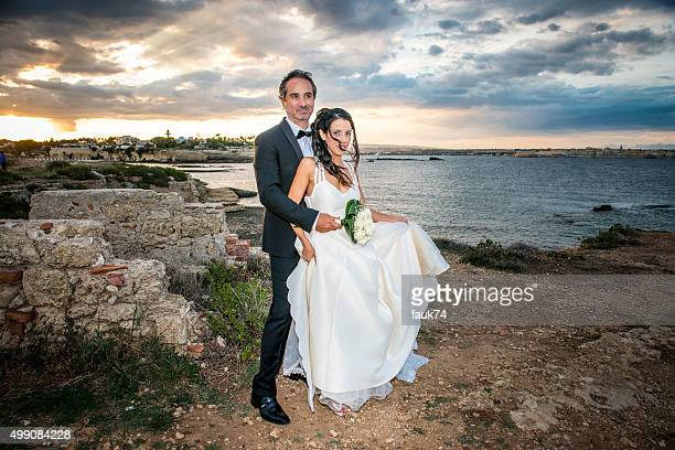 Newlyweds at Plemmirio park, in Sicily.
