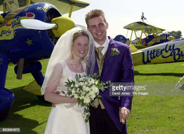 Newlyweds Caroline Hackwood and Justin Bunn after their airbourne wedding ceremony strapped to the wings of 1940's Boeing Stearman biplanes in...
