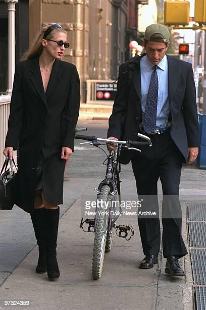 Newlyweds Carolyn Bessette Kennedy and John F Kennedy Jr walk along Varick Street in Manhattan