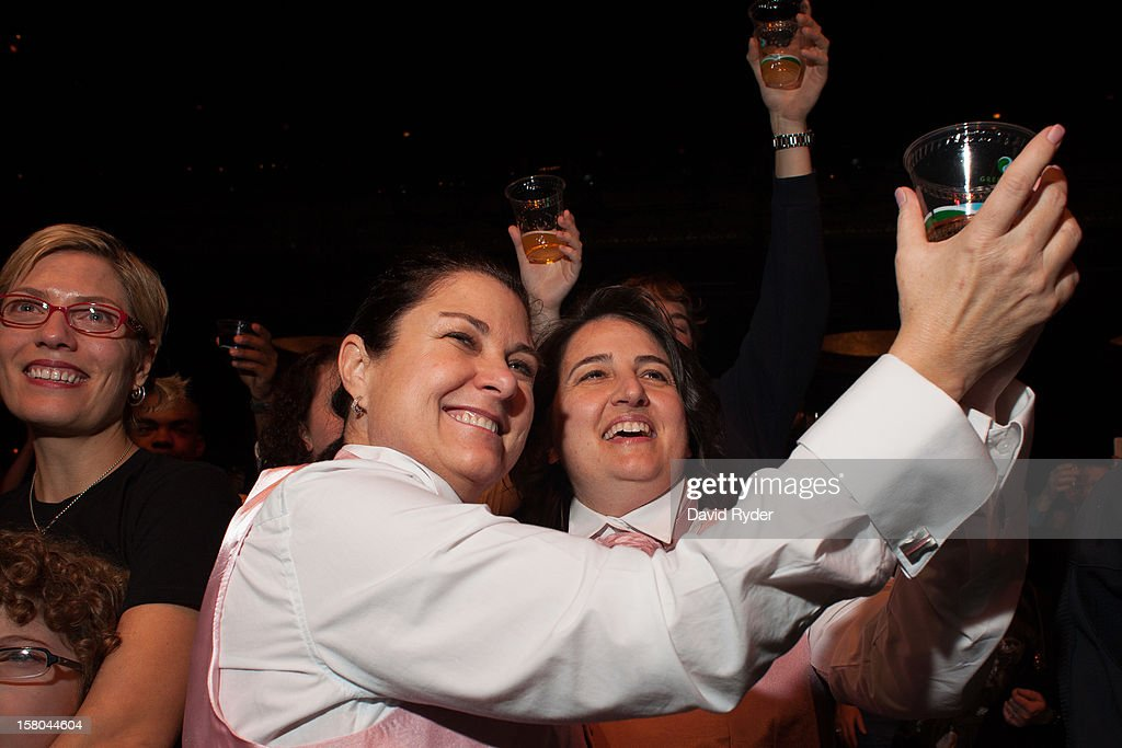 Newlyweds Cathi Korth and Kathryn Antonetti raise a glass during a ceremonial toast at 'A Wedding Reception for All,' which was attended by hundreds and held at the Paramount Theatre on December 9, 2012 in Seattle, Washington. They have been together for 25 years, 11 months, and 13 days. Today is the first day that same-sex couples can legally wed in Washington state.