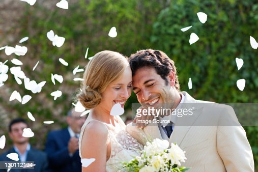 Newlyweds embracing at marriage ceremony : Stock Photo